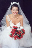 Beautiful bride. With bouquet of roses Stock Photo