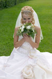 The beautiful bride. The beautiful bride with a bouquet of flowers Stock Photos