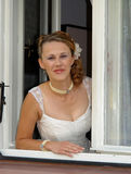 Beautiful bride. Impatiently waiting for arrival of her groom Stock Photo