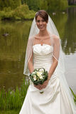 Beautiful bride. Standing on her weddingday looking excited Royalty Free Stock Photos