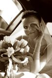 Beautiful bride. Beautiful the bride in car. b/w+sepia Royalty Free Stock Images