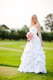 Beautiful bride. A shot of a beautiful caucasian bride outdoor stock images