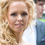 Beautiful Bride. Close-up - a charming bride with curly locks watching us happy eyes Stock Photo