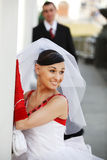 Beautiful bride. With groom on the background royalty free stock images