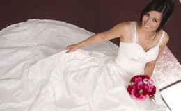 Beautiful Bride Gown Spread out Beneath Her Stock Images