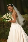 Beautiful bride. With bouquet in park Royalty Free Stock Image