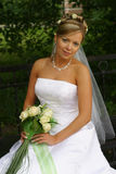 Beautiful bride. The beautiful bride with a bouquet from roses Stock Image