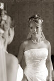 Beautiful bride. The beautiful bride looks at itself in a mirror. b/w+sepia royalty free stock photos