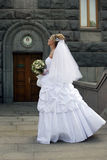 Beautiful bride. The beautiful bride with a bouquet on a background of church Stock Images