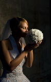 Beautiful bride. With bouquet of white flowers Royalty Free Stock Image