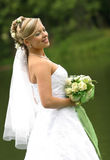 Beautiful bride. Portrait of the beautiful bride with a bouquet Stock Photography