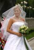 Beautiful bride. Portrait of the beautiful bride in veil with a bouquet Stock Photo