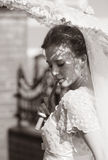 Beautiful bride. The beautiful bride closed by a umbrella from the sun Stock Photo