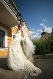 Beautiful bride. The beautiful bride on a background of a private residence Royalty Free Stock Photos