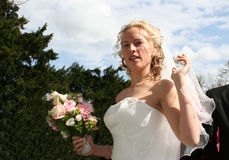 The Beautiful Bride. The bride approaches the church stock photos