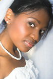 Beautiful Bride. Beautiful African bride dressed in a white gown stock photography