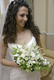 Beautiful bride. Beautiful smiling caucasian bride with bouquet Royalty Free Stock Photos