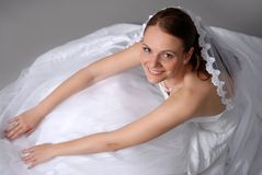 Beautiful Bride. Beautiful young bride looks at the camera and smiles royalty free stock photography