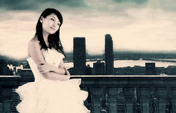 A beautiful bride. A beautiful asian bride poses on the outdoor terrace Stock Photo