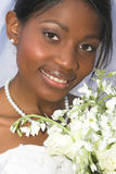 Beautiful Bride. Beautiful African bride dressed in a white gown stock image