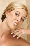 Beautiful Bride. Beautiful Blond bride wearing diamond jewelery on her wedding day royalty free stock image