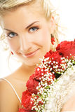 Beautiful bride. Hiding behind luxury bouquet of roses Stock Photo