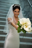 Beautiful bride. Beautiful Young Brunette Bride Smiling with bouuet Stock Photo