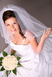 Beautiful bride. With rose bouquet Royalty Free Stock Photos
