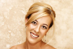 Beautiful Bride. Beautiful Blond bride wearing diamond jewelery on her wedding day royalty free stock photography