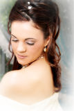 Beautiful Bride. Beautiful brunette bride looking down, close up royalty free stock photo