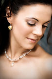 Beautiful Bride. Beautiful brunette bride wearing heart shaped jewelery royalty free stock images