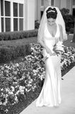 Beautiful Bride. Beautiful Brunette Bride Outdoors with her bouquet Stock Photography