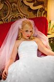 Beautiful bride. An image of a beautiful bride sitting in an oversized red chair Royalty Free Stock Photography
