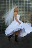 Beautiful bride. An image of a beautiful bride playfully running down the sidealk Royalty Free Stock Photography