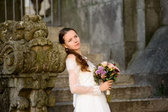 Beautiful bride against a brick wall Stock Photography