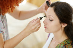 Beautiful bride applying make-up Royalty Free Stock Image