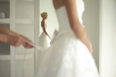 Beautiful bride. Art photo of a beautiful bride. Dressing gowns Royalty Free Stock Photography