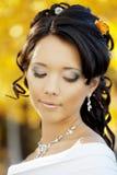 Beautiful bride in the autumn park Stock Photos
