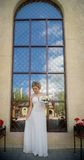 Beautiful bride on background of large window Royalty Free Stock Image