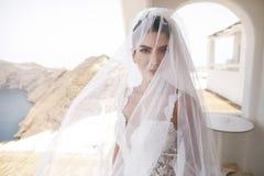 Beautiful bride on the balcony royalty free stock photography