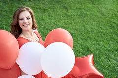 Beautiful bride with balloons in the park Royalty Free Stock Images