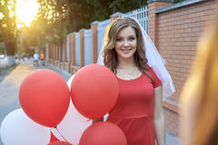 Beautiful bride with balloons in the park Stock Photos