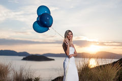 Beautiful bride with balloons Stock Photo