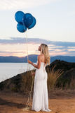 Beautiful bride with balloons Stock Image