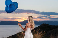 Beautiful bride with balloons Royalty Free Stock Images