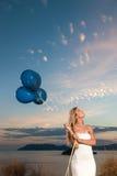 Beautiful bride with balloons Stock Photos