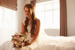 Beautiful Bride In Bedroom Sitting On Bed Royalty Free Stock Image