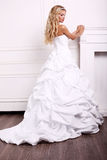 Beautiful bride with blond hair in wedding dress Stock Images