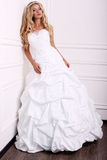 Beautiful bride with blond hair in wedding dress Stock Photo