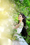 Beautiful bride in a blossoming garden. The image of a beautiful bride in a blossoming garden Stock Image